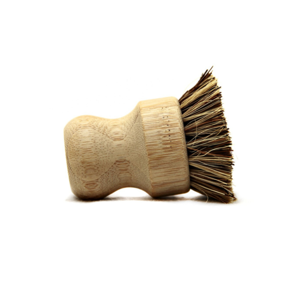 Bamboo pot brush on its side
